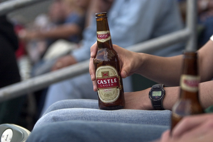 castle lager: somewhat dry, somewhat bitter, never sweet.